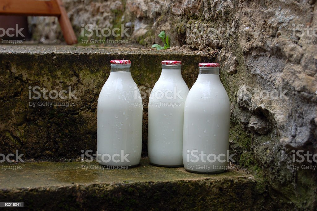 morning milk bottles on door step stock photo