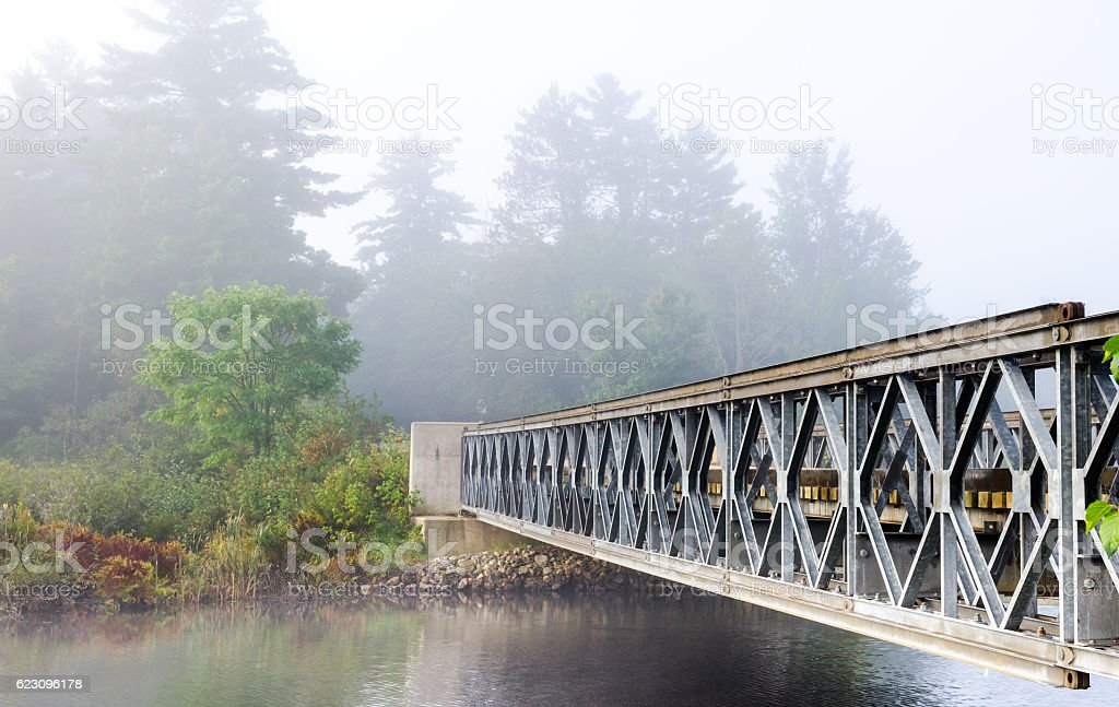 Morning mist at Bridge over Corry lake. stock photo