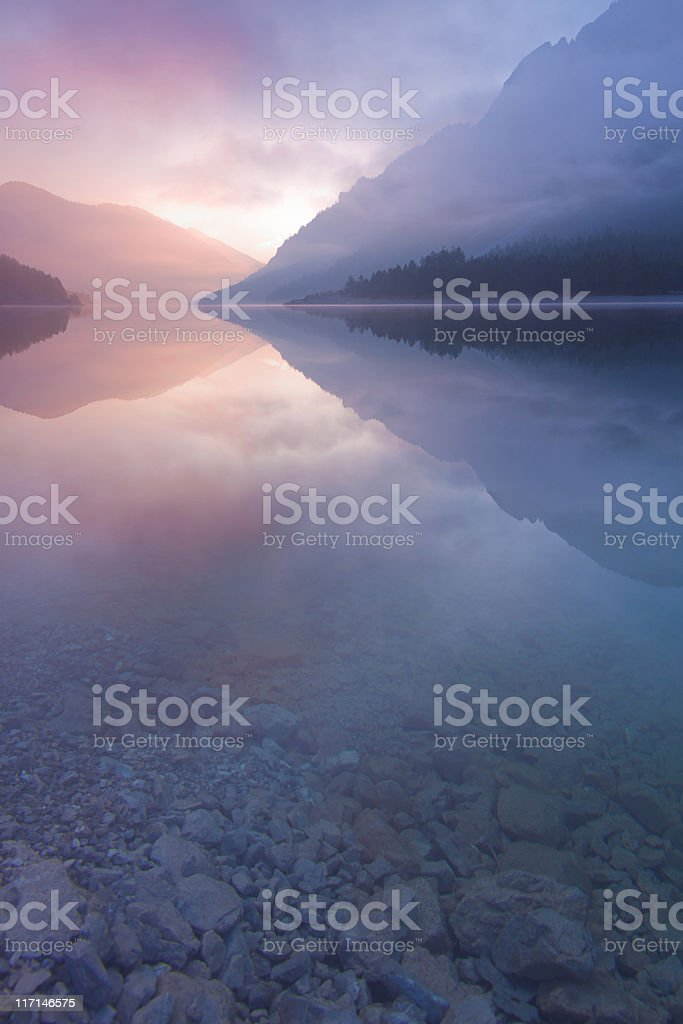 morning mist at lake plansee, tirol, austria, vertical royalty-free stock photo