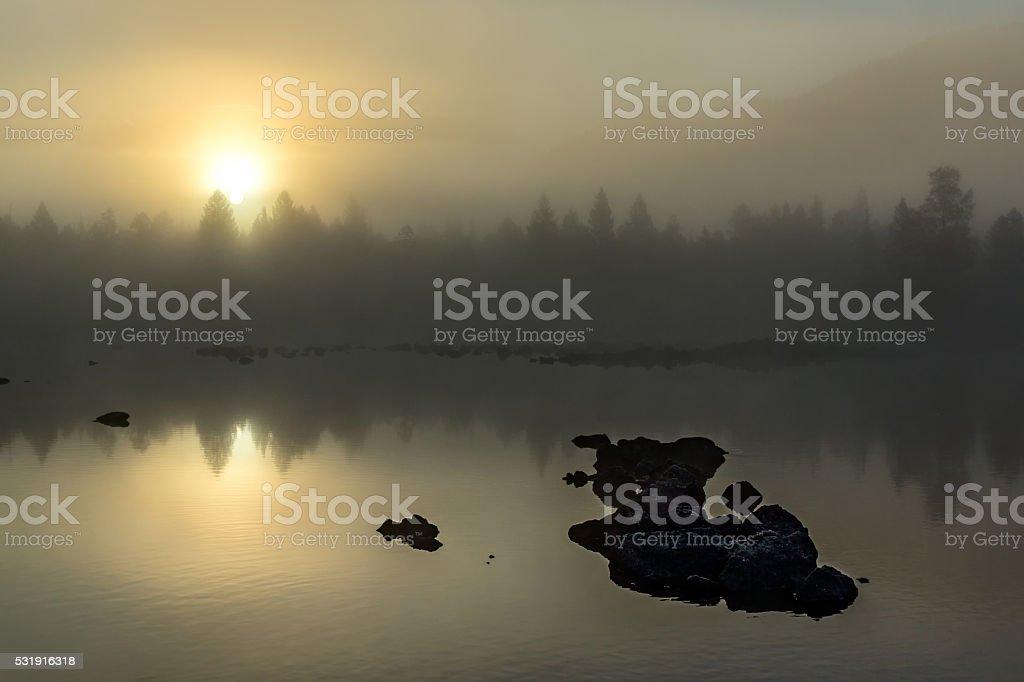 Morning mist on the river Zhombolok stock photo