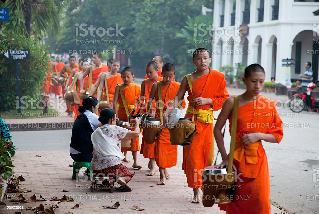 Morning monk procession in Luang Prabang, Laos stock photo
