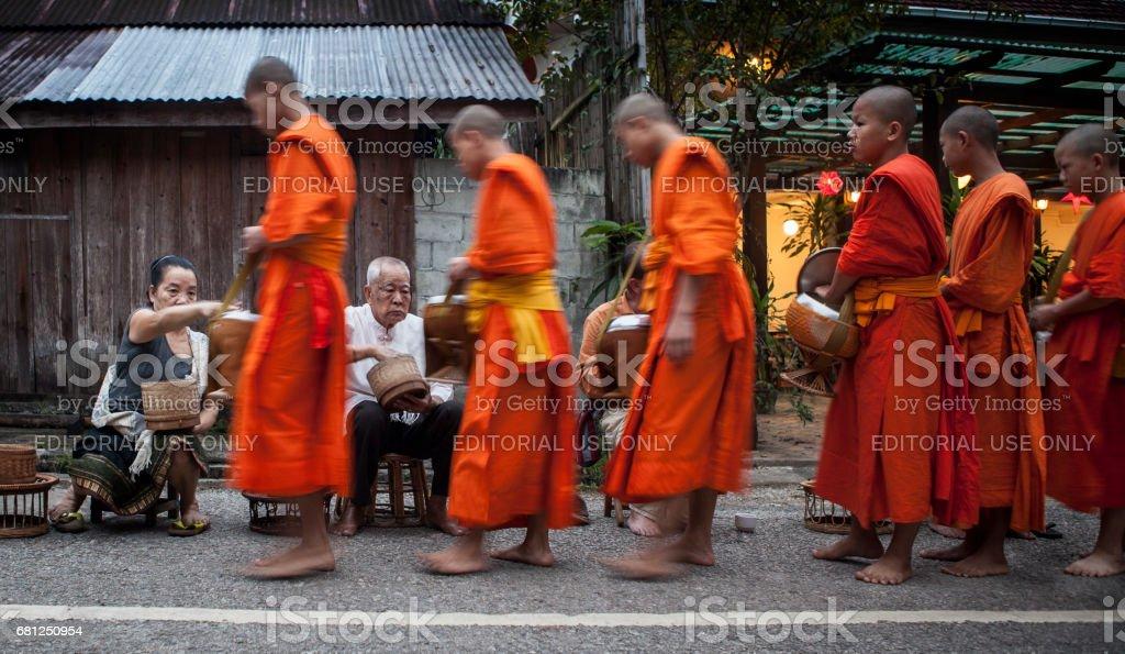 Morning monk procession in Luang Prabang, Laos stock photo