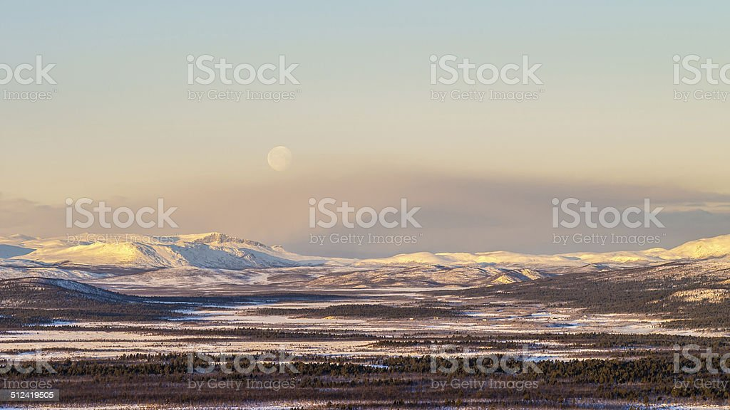 Morning moon rise over mountains in northern Sweden stock photo