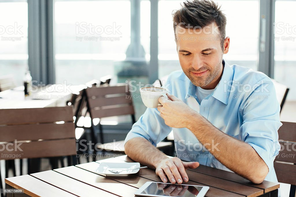 Morning news catch-up with a coffee stock photo