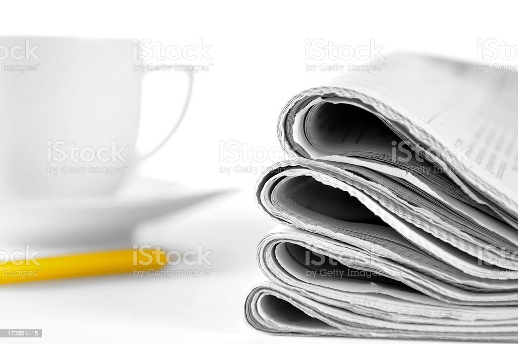 Morning news! Stack of newspapers, coffe cup, pencil on table royalty-free stock photo