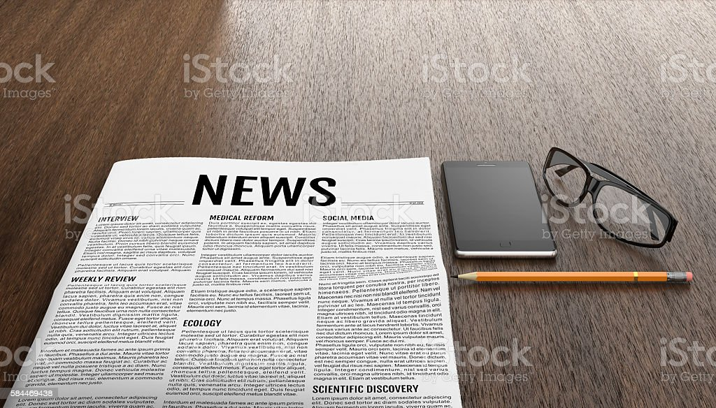 Morning newspapers on wooden table. stock photo