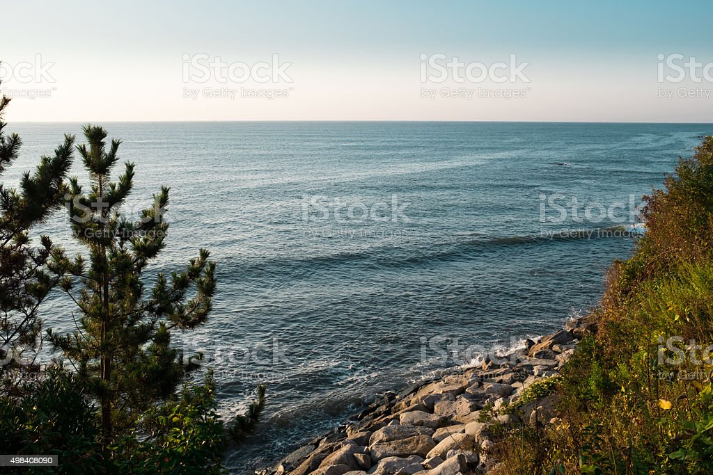 Morning ocean vista with rocky beach stock photo