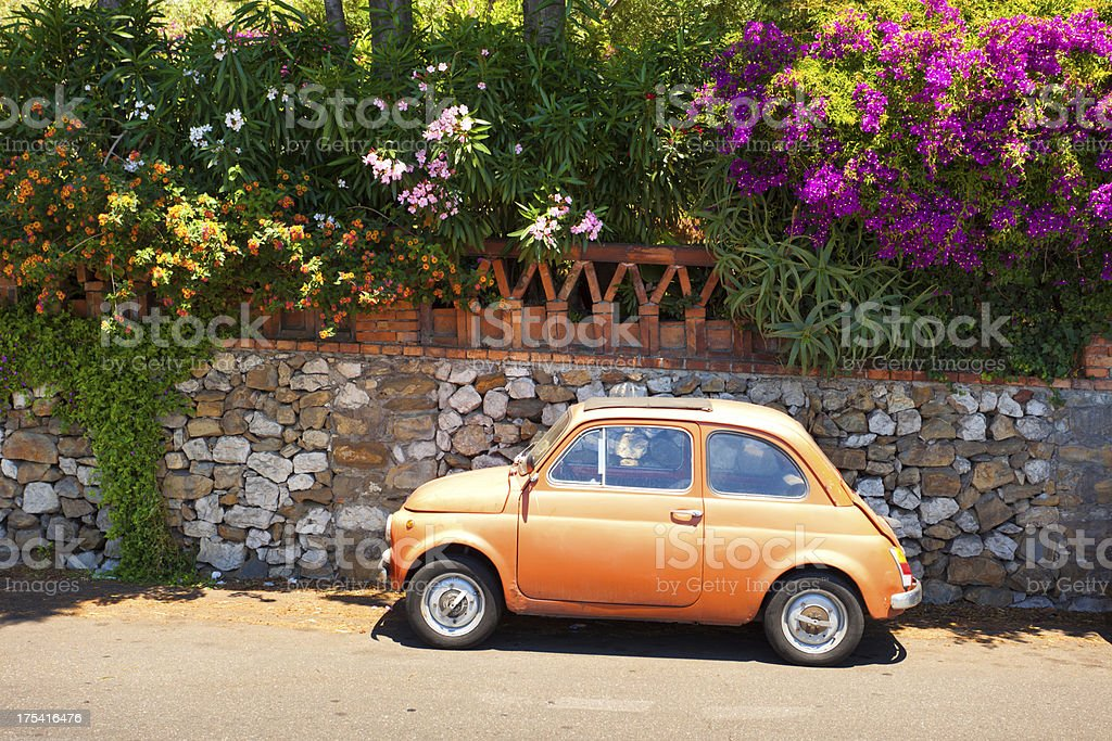 morning of Taormina and lovely tiny italian car stock photo