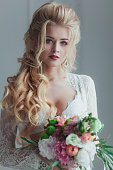 Morning of the bride. Beautiful young woman in white negligee
