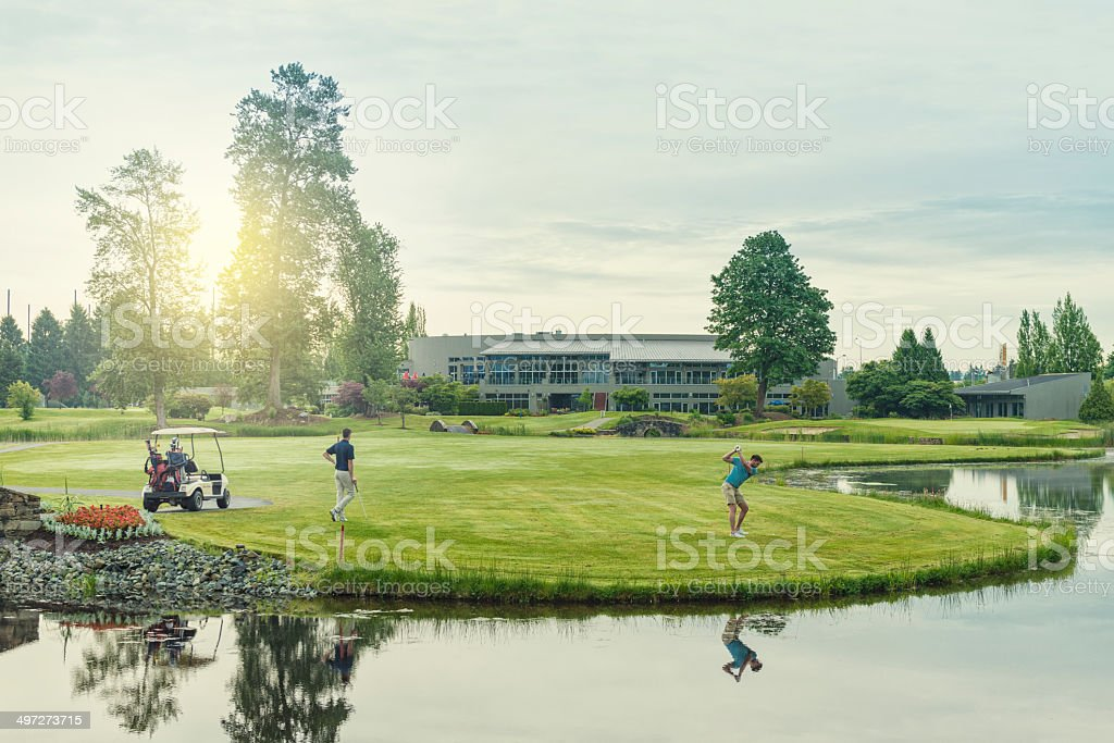 Morning or Evening Golfers stock photo