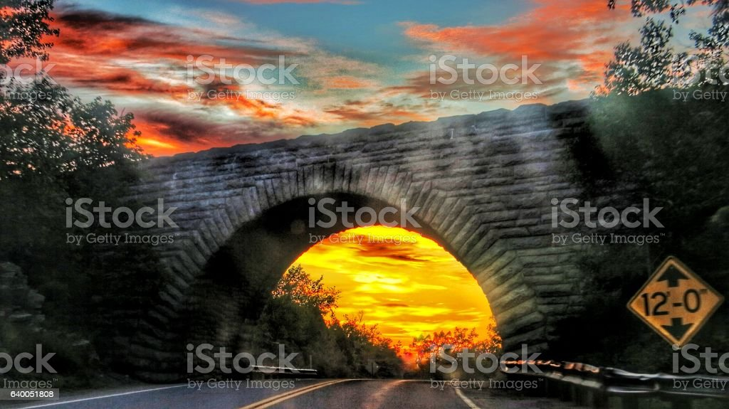 Morning Pink Fire Sky, Road Underpass, Acadia National Park, Maine stock photo