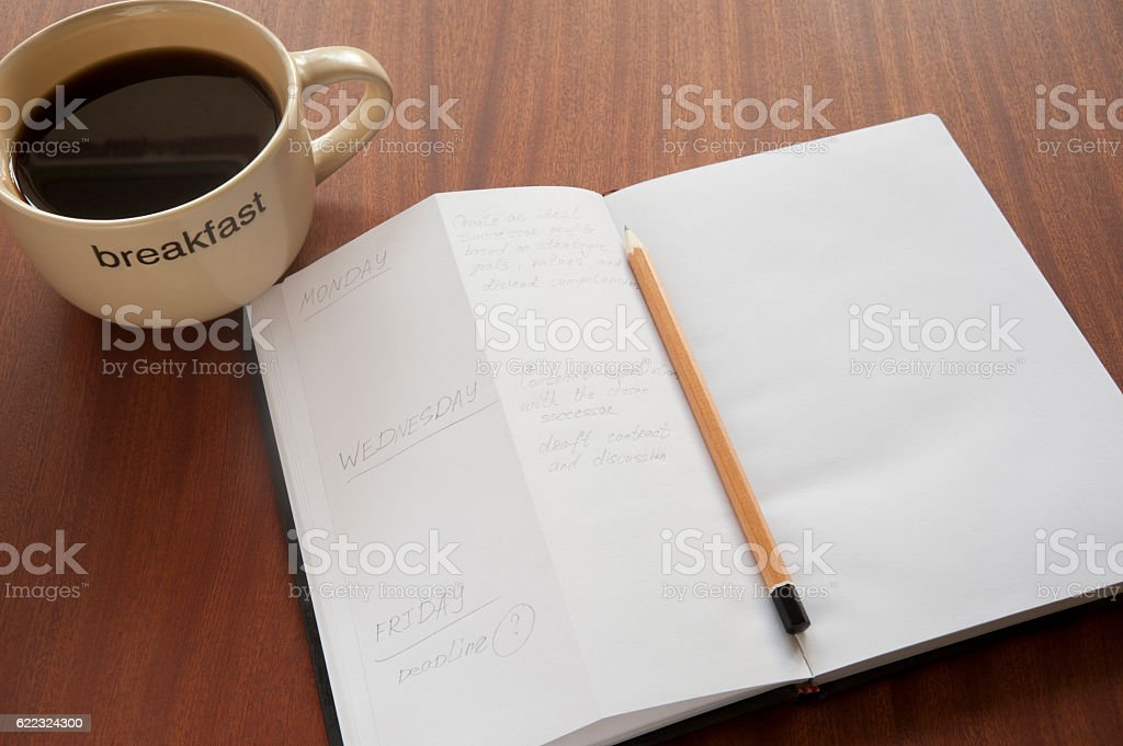 Morning planning with cup of coffee stock photo
