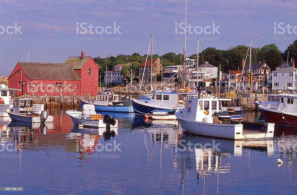 Morning reflections in harbor with fishing boats Rockport Massachusetts stock photo