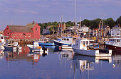 Morning reflections in harbor with fishing boats Rockport Massachusetts