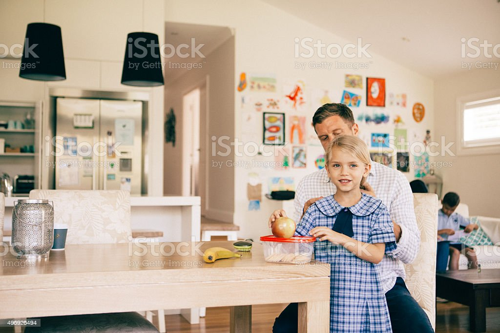 morning routines of getting the kids ready for school stock photo