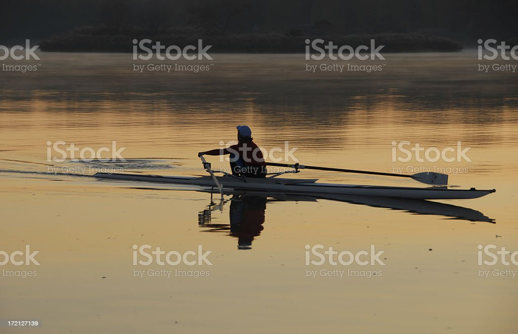 morning rowing routine stock photo