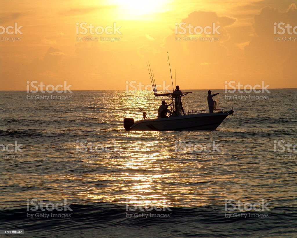 Morning Silhouetted Fisherman stock photo