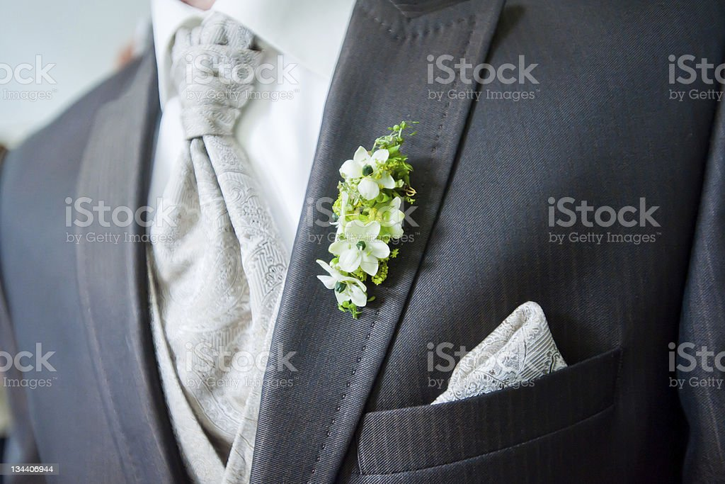 Morning suit chest and buttonhole flowers. stock photo