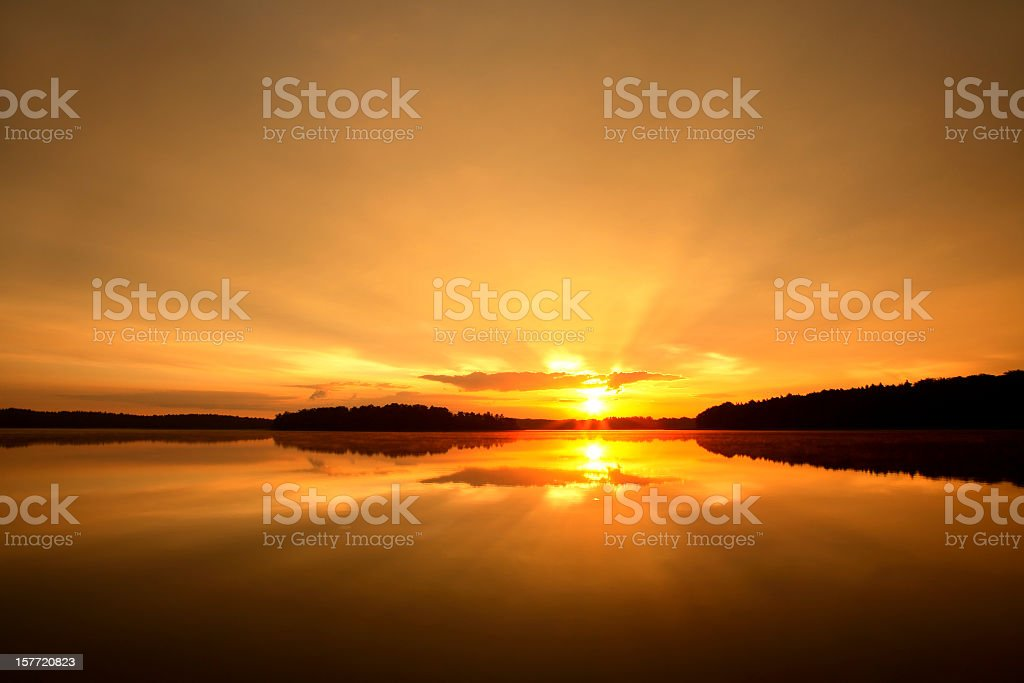 Morning Sun, Amazing Sunrise over a Calm Lake royalty-free stock photo