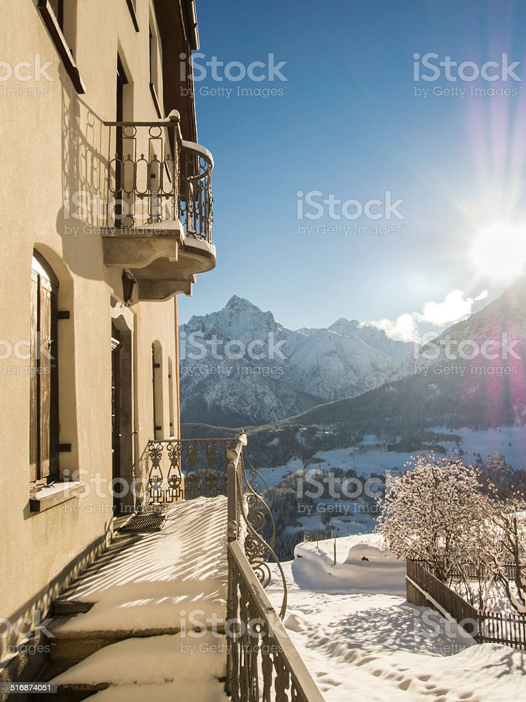 Morning sun and mountain village in winter stock photo