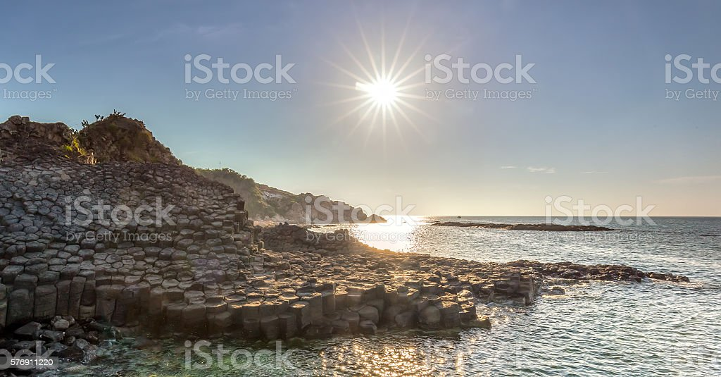 Morning sun on Giant Causeway stock photo