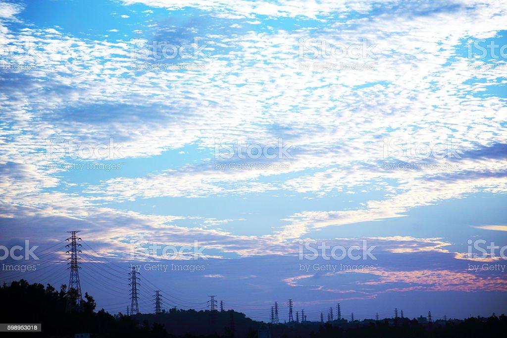 Morning sun and steel tower stock photo