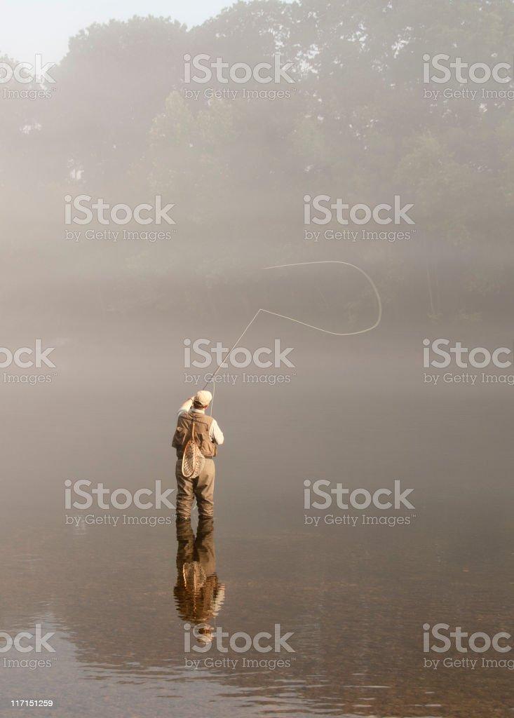 Morning Sunlight on Flyfisherman in the Fog royalty-free stock photo