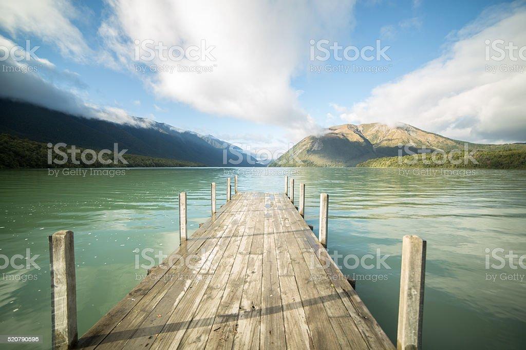 Morning sunlight on wooden pier, lake Rotoiti stock photo