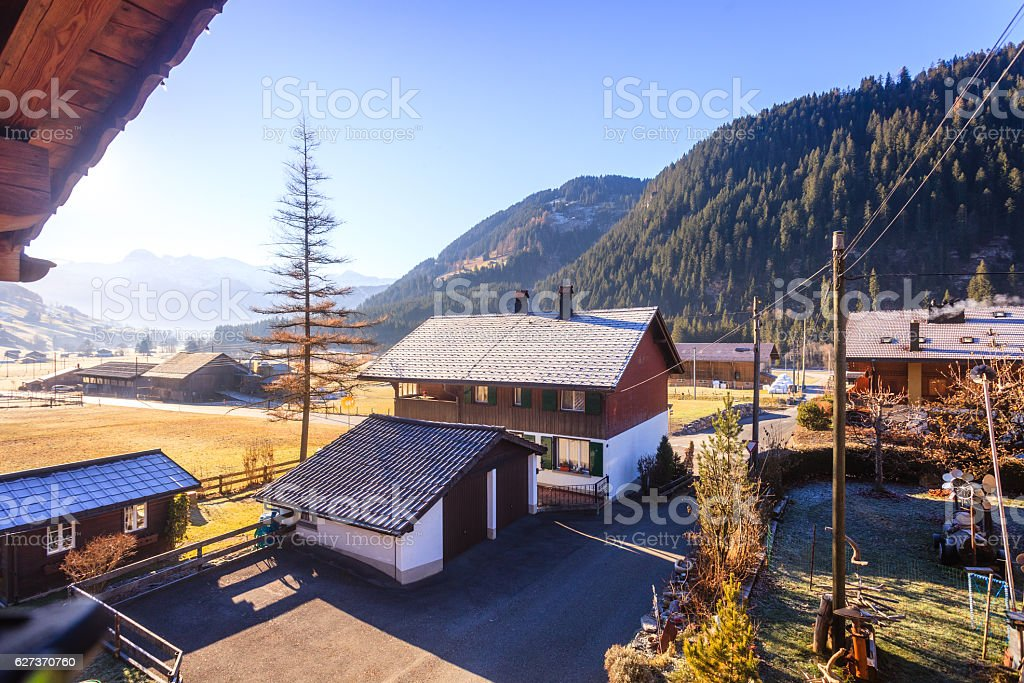 Morning sunlight, Swiss Alps, houses and barns stock photo