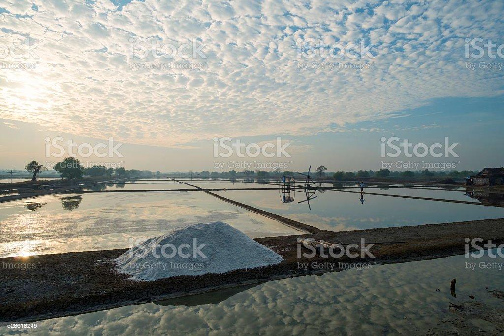 Morning sunrise beautiful cloud formation in salt field or salt stock photo