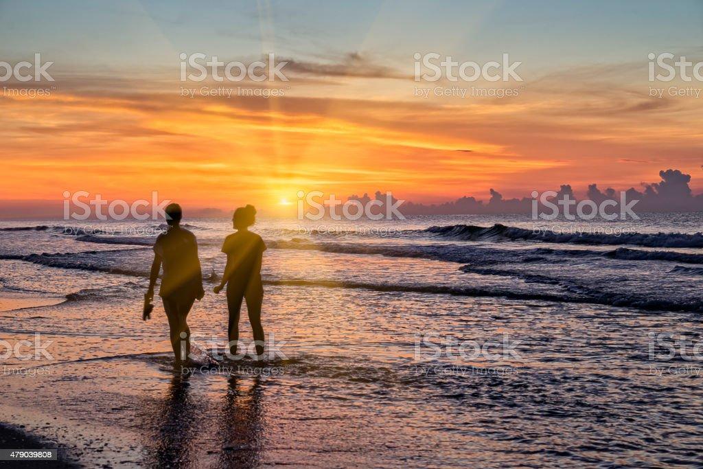 Morning sunrise walk at the beach. stock photo