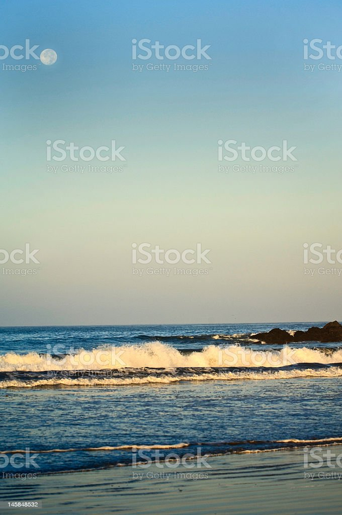 Morning Surf with Moon royalty-free stock photo