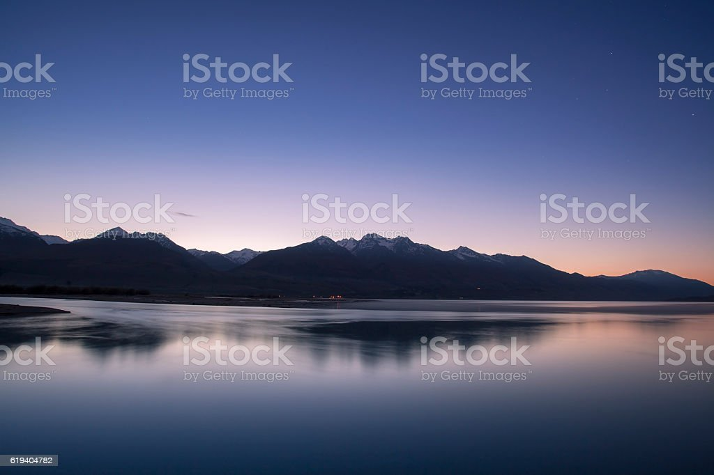 Morning twilight and mountain peak in New Zealand stock photo