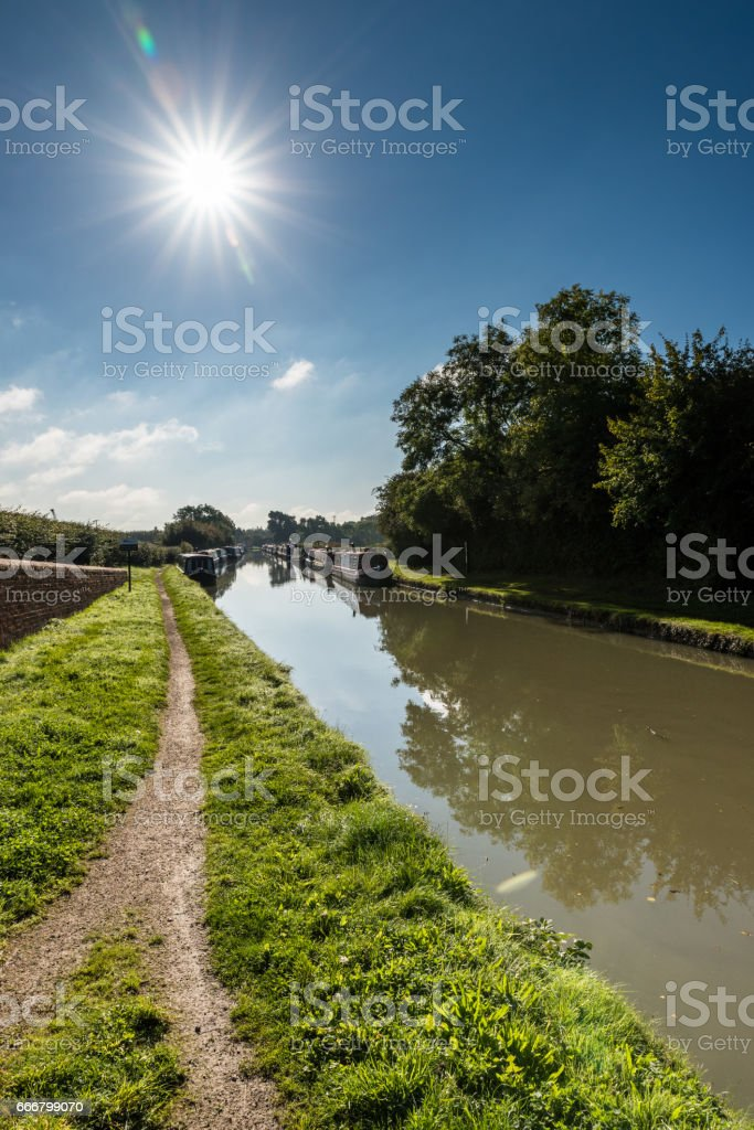 Morning view of empty path along canal in England stock photo