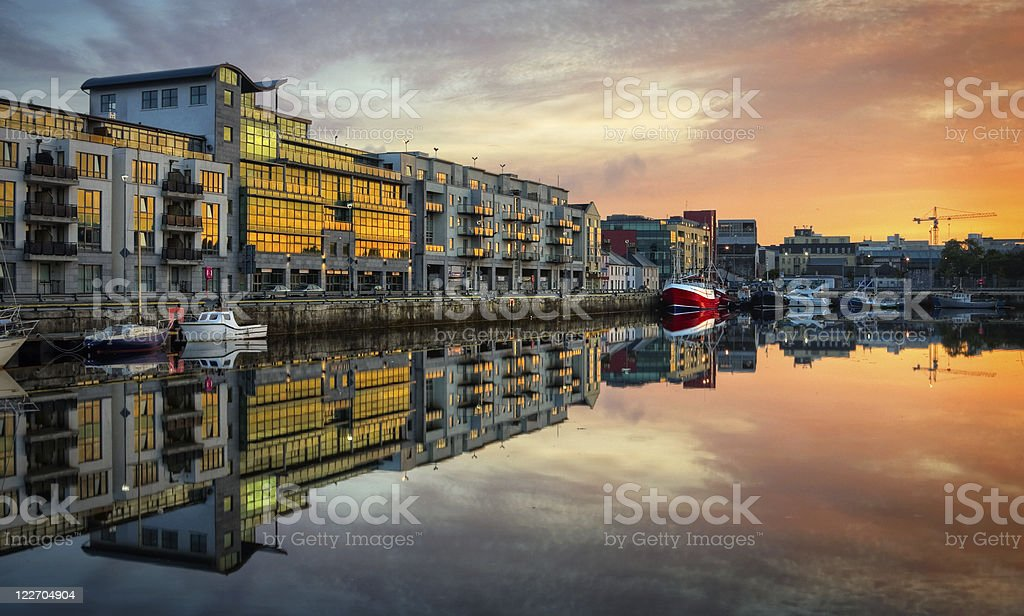 morning view on Dock with boats reflected in water, HDR stock photo