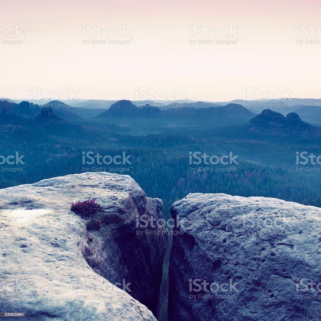 Morning view over sandstone cliff, daybreak Sun at horizon. stock photo