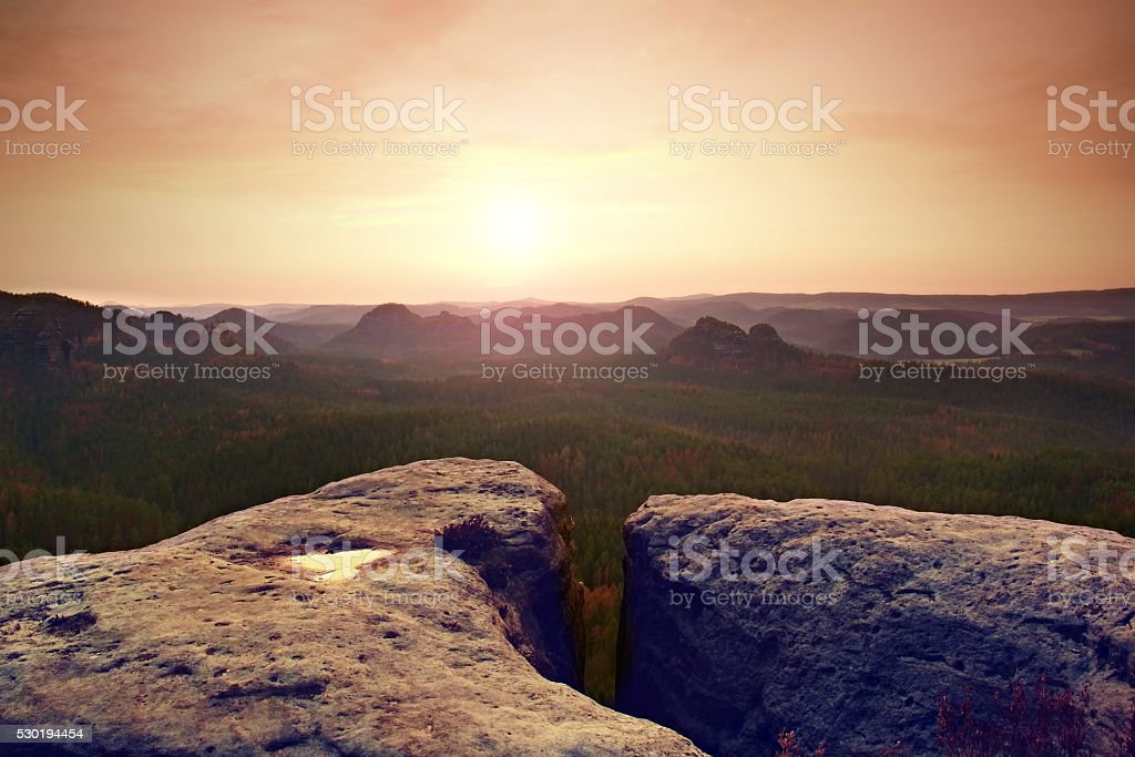 Morning view over sandstone cliff into forest valley, daybrea stock photo