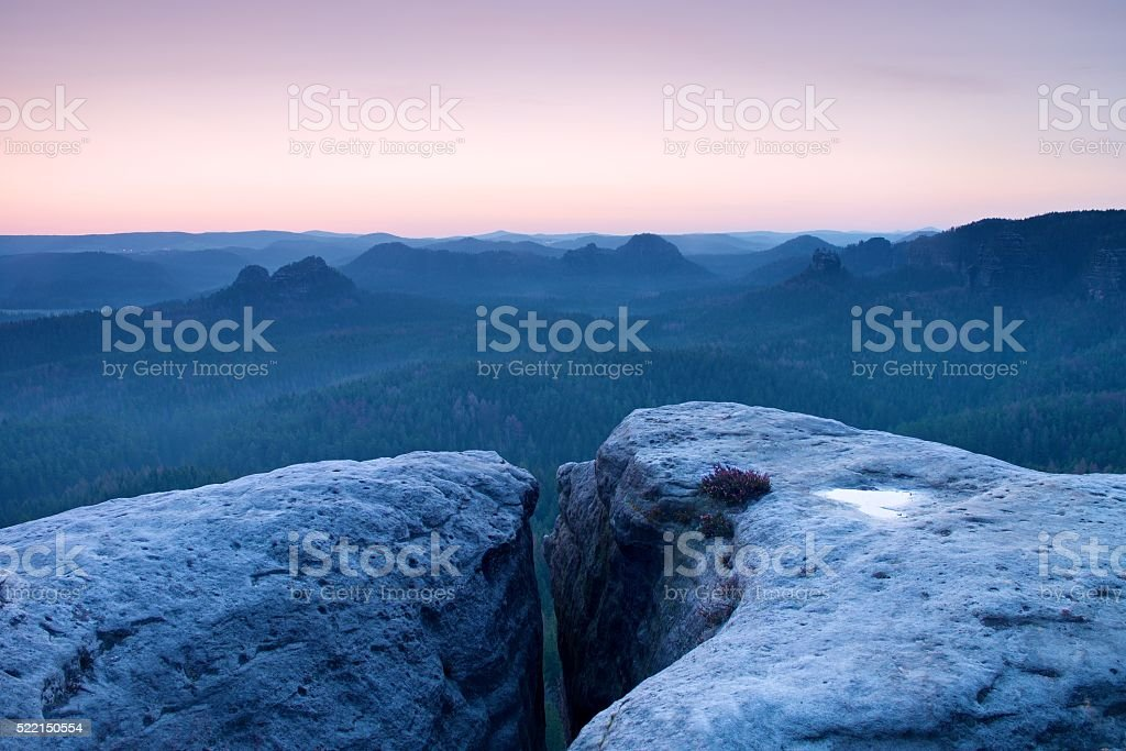 Morning view over sandstone cliff into forest valley, daybreak Sun stock photo