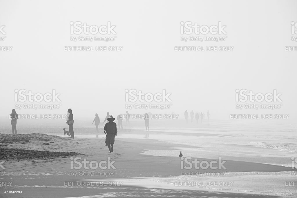 Morning walkers in the mist in Ocean Beach, San Francisco royalty-free stock photo