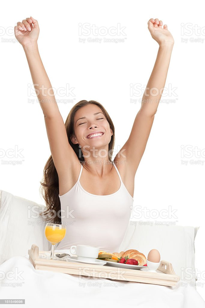 Morning woman in bed with breakfast royalty-free stock photo