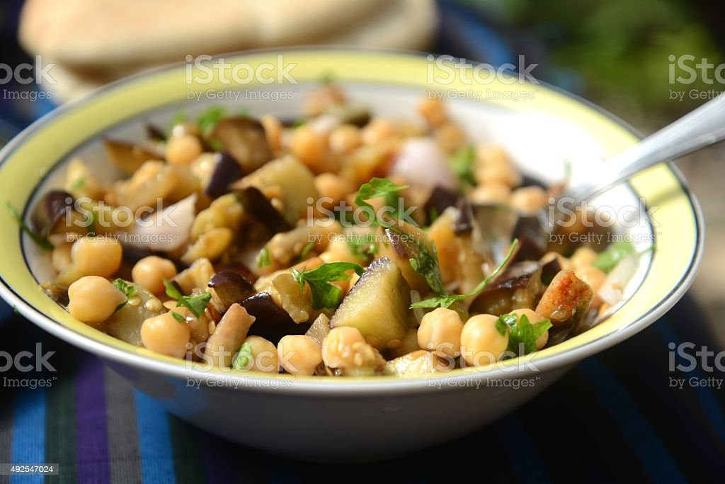 Moroccan aubergine and chickpea salad stock photo