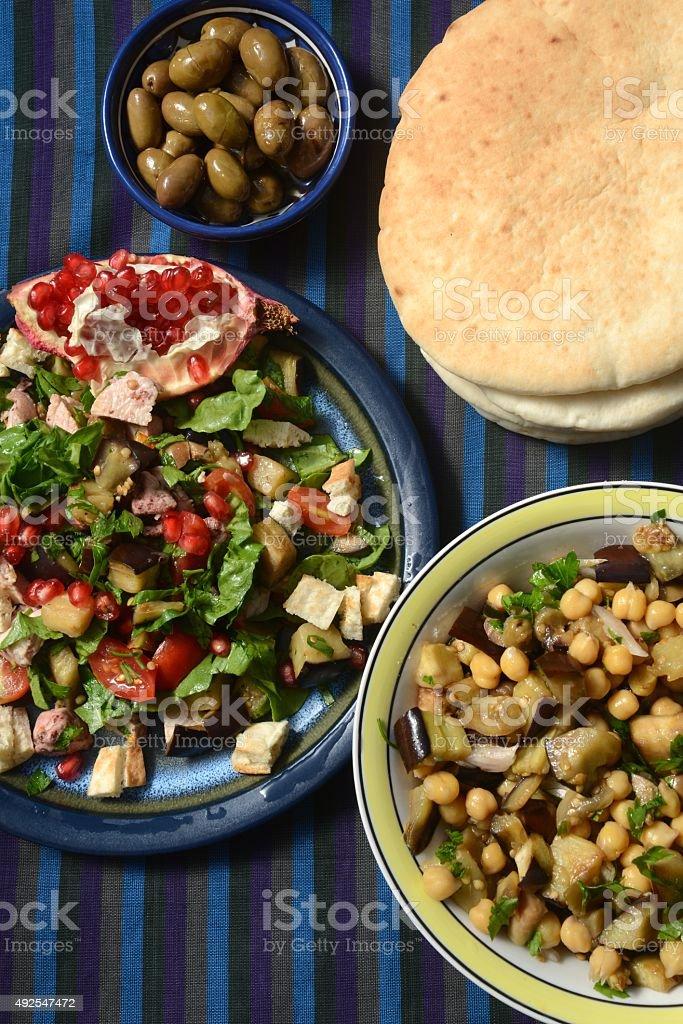 Moroccan aubergine , chickpea and chicken salads stock photo