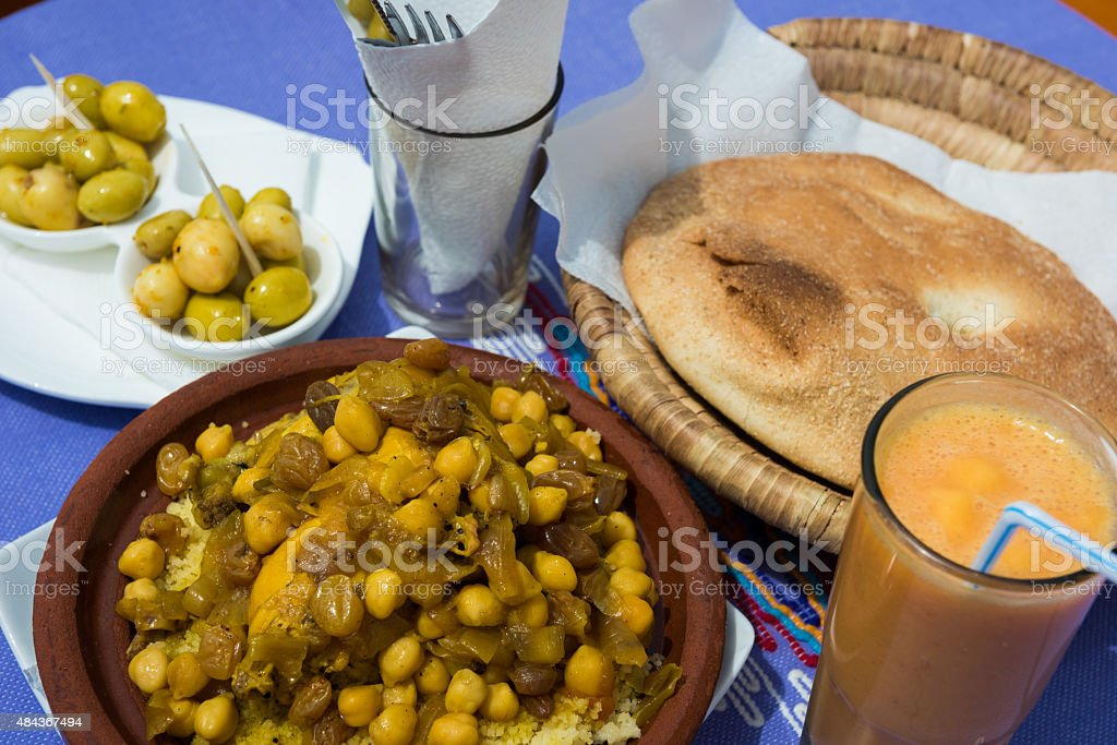 Moroccan chicken couscous with chic peas, raisins and onions stock photo
