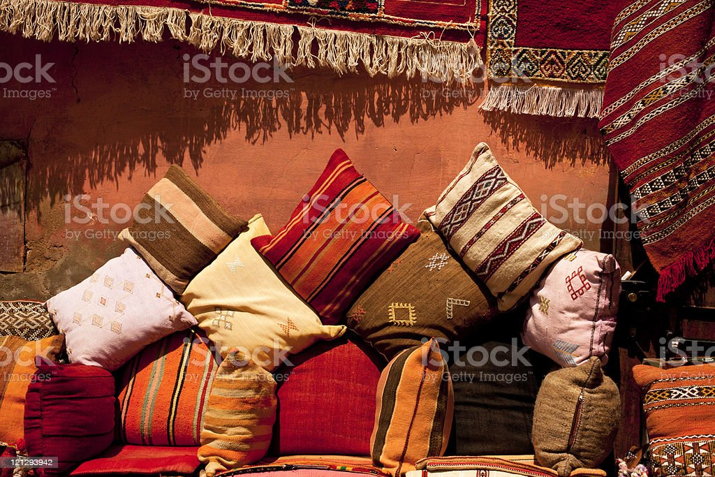 Moroccan cushions on a street shop in medina souk stock photo