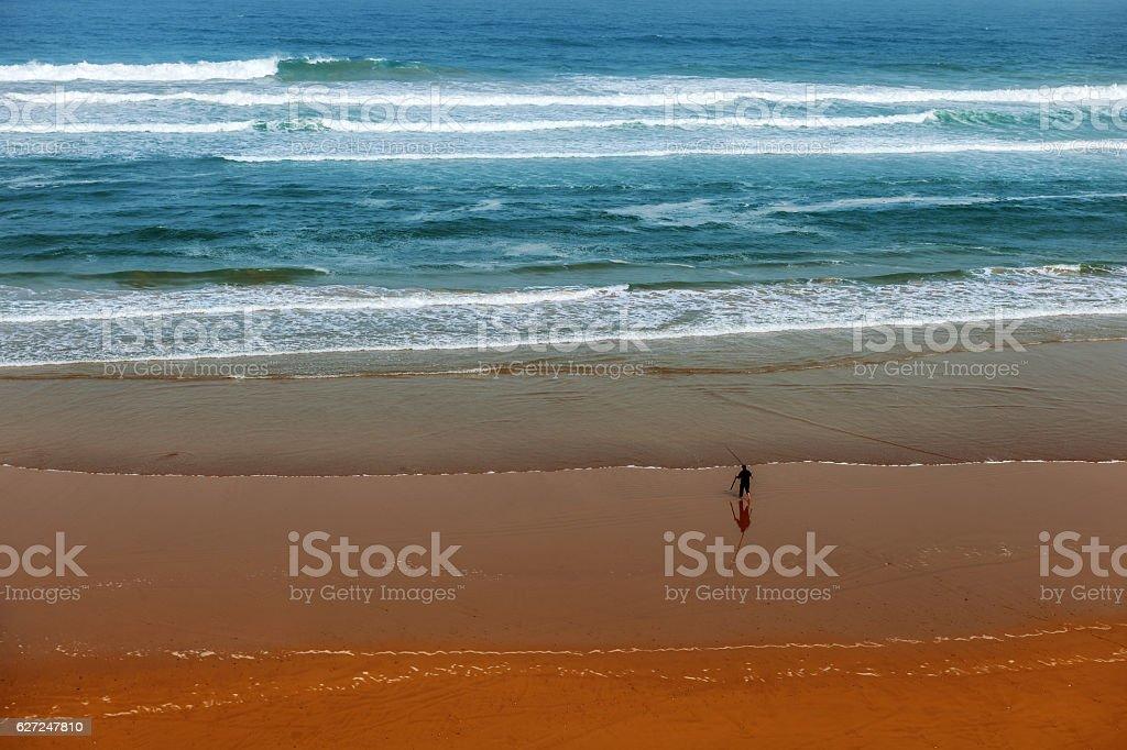 Moroccan Fisherman Along white waves,Agadir,Morocco,North Africa stock photo