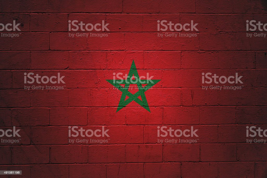 Moroccan Flag painter on a wall stock photo