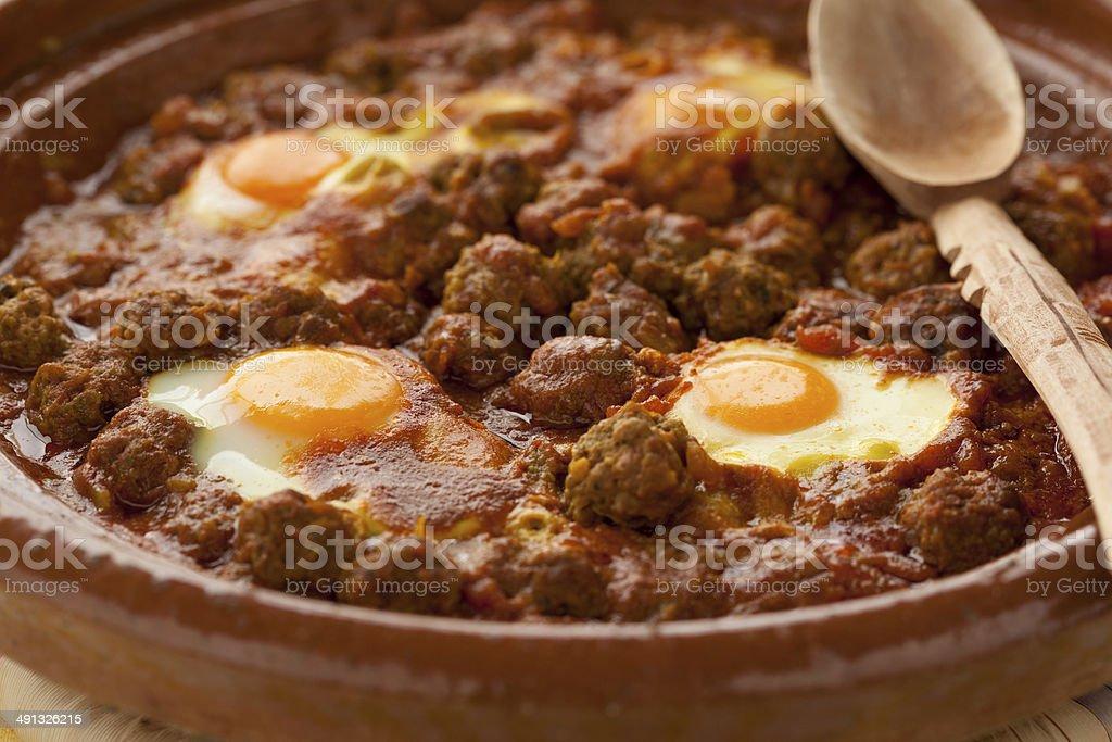 Moroccan kefta tagine with eggs (Mkaouara) stock photo