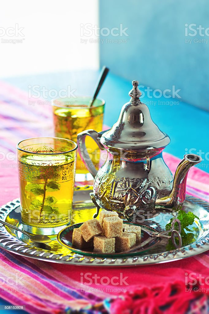 Moroccan Mint Green Tea With Fresh Herbs and Sugarcubes stock photo