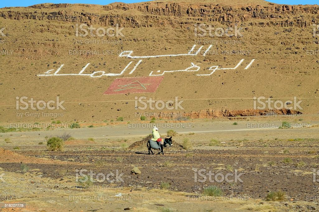 Moroccan on a Donkey in Tinejdad stock photo