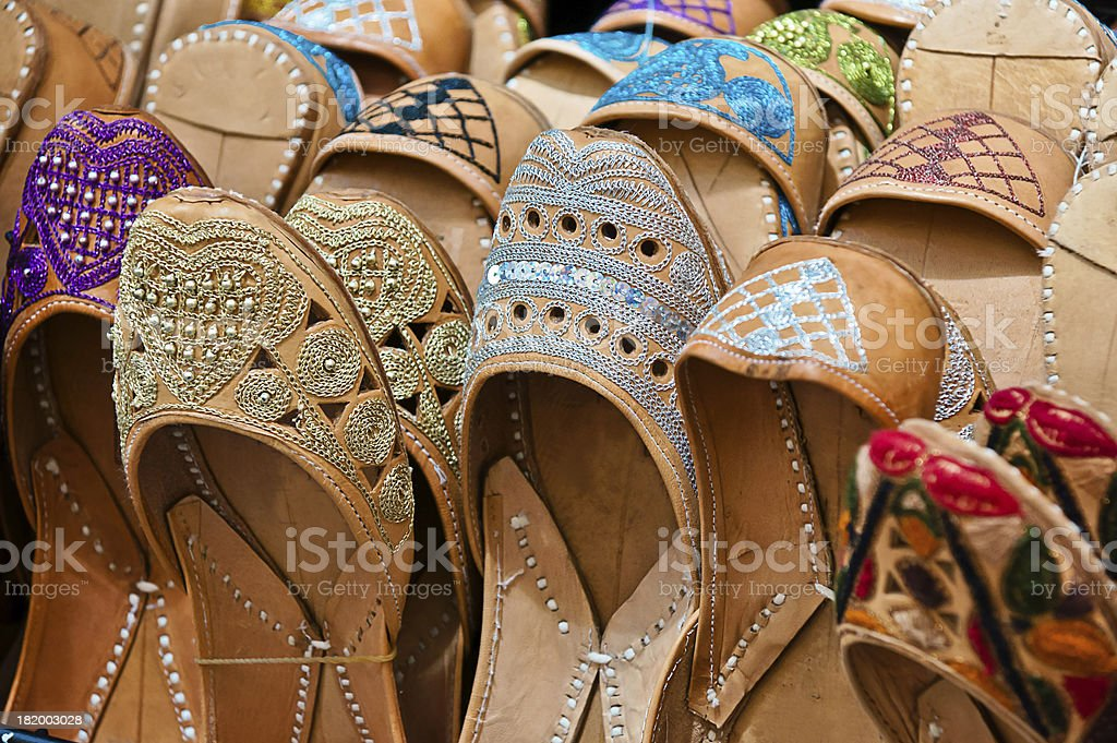 moroccan slippers in a market royalty-free stock photo